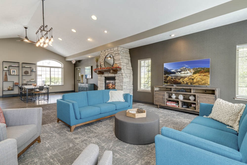 Clubhouse with TV lounge and tables for residents at Stone Creek Villas townhomes in west Omaha NE 68116
