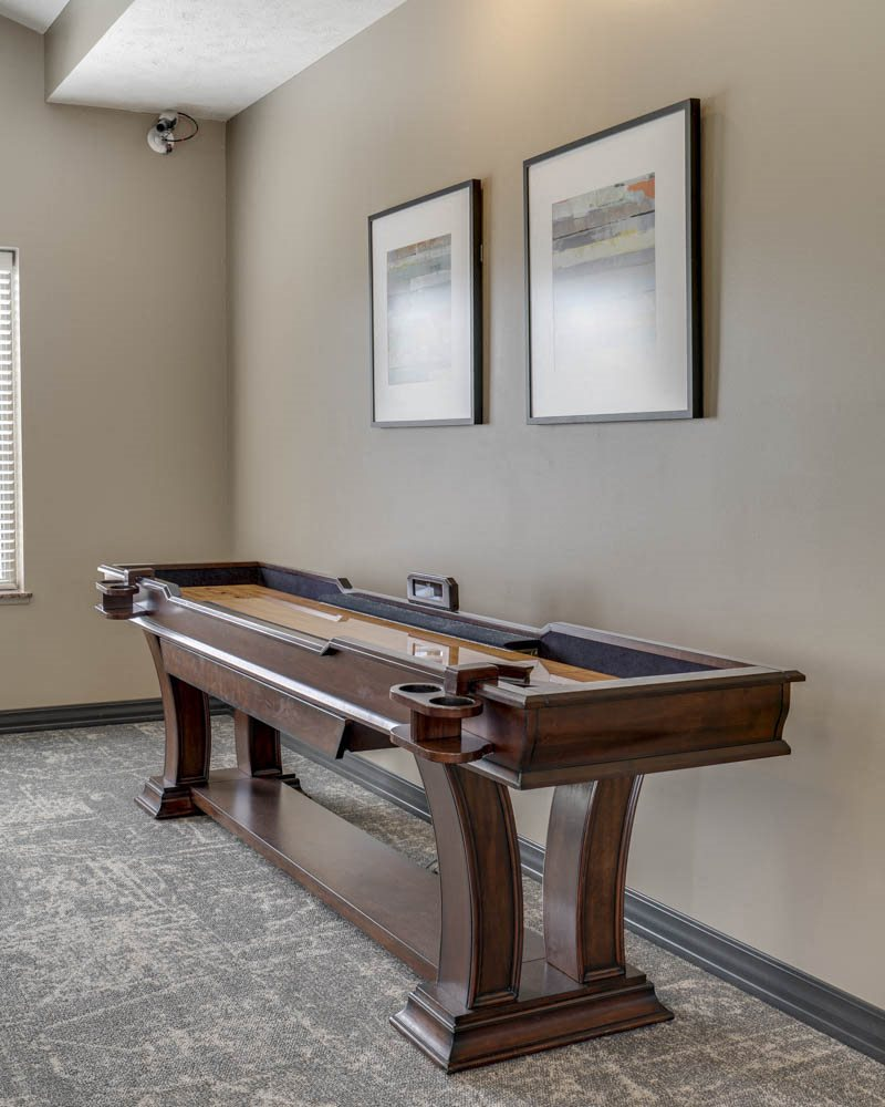 Shuffleboard table at Stone Creek Villas townhomes in west Omaha NE 68116