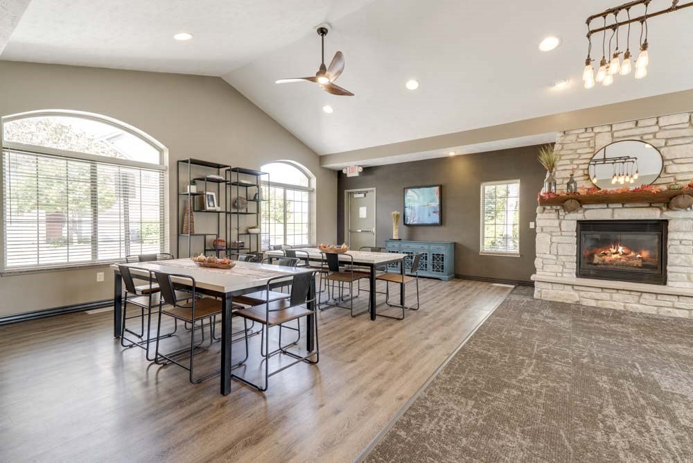 Tables and seating in clubhouse at Stone Creek Villas townhomes in west Omaha NE 68116