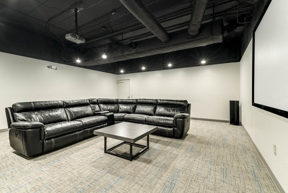 Movie theater room with sectional couch at Stone Creek Villas townhomes in west Omaha NE 68116