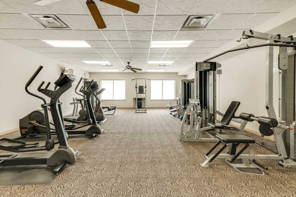 24-hour fitness center with cardio equipment, weightlifting machines and free weights at Stone Creek Villas townhomes in west Omaha NE 68116