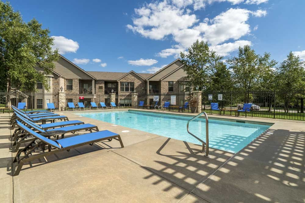 Swimming pool with lounge chairs at Stone Creek Villas townhomes in west Omaha NE 68116