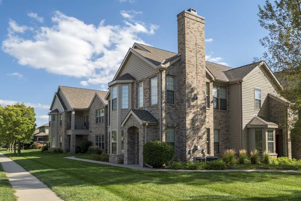Exterior view of private entrances and large windows at Stone Creek Villas townhomes in west Omaha NE 68116