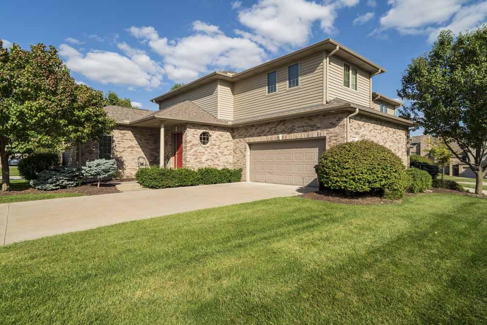 Two-car attached garage with private entrance at Stone Creek Villas townhomes in west Omaha NE 68116