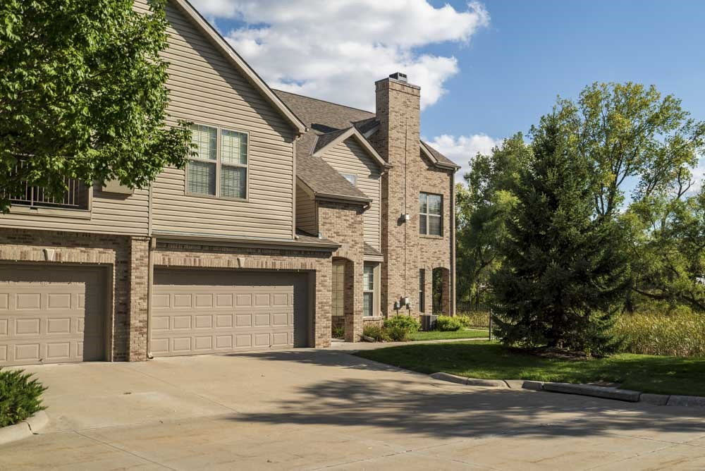 Attached two-car garages with private entrances at Stone Creek Villas townhomes in west Omaha NE 68116
