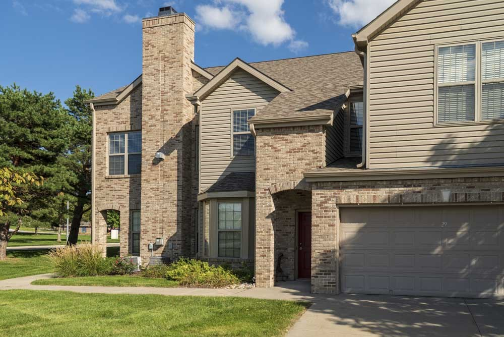 Private entrance with two-car attached garage at Stone Creek Villas townhomes in west Omaha NE 68116