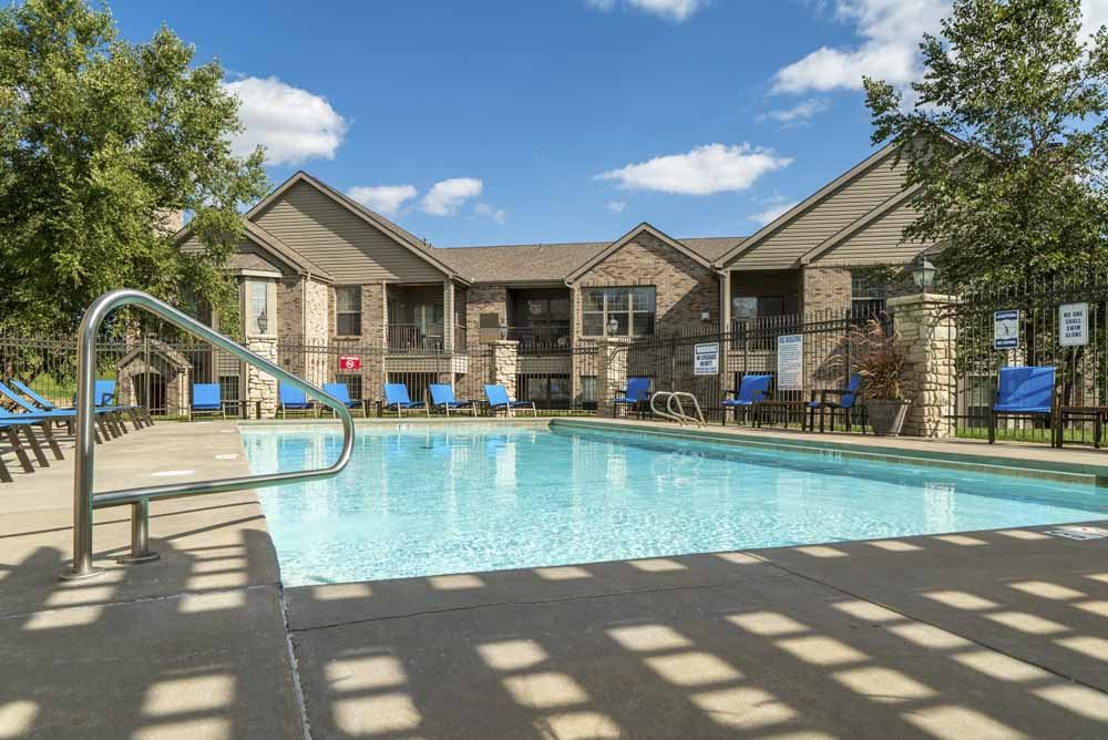 Outdoor pool with lounge seats at Stone Creek Villas townhomes in west Omaha NE 68116