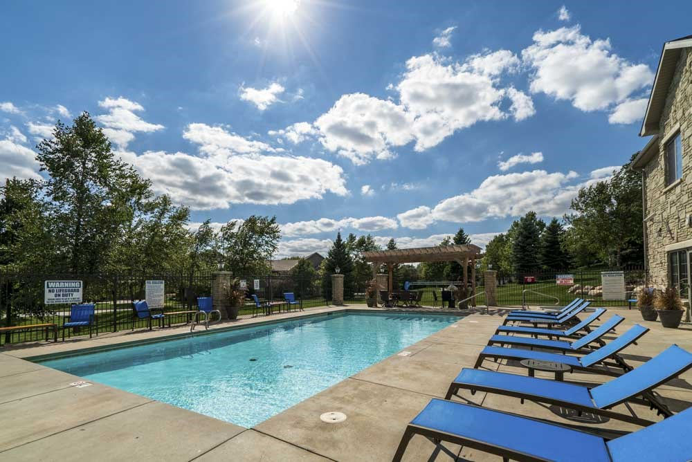 View of swimming pool and pergola at Stone Creek Villas townhomes in west Omaha NE 68116