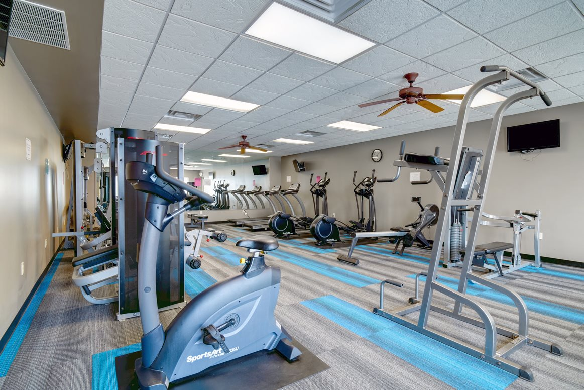 Expansive fitness center includes free weights, cardio and weigh machines