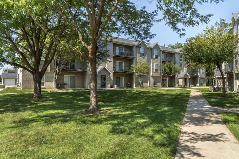 Walkway with greenspace to Eagle Run Apartments in northwest Omaha 68164