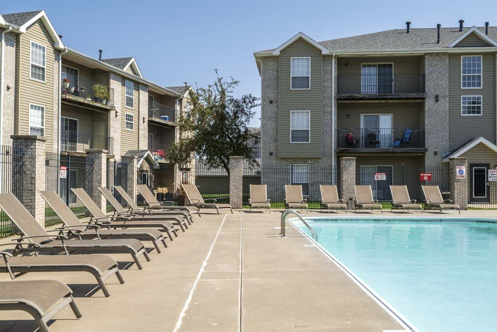 Outdoor swimming pool with lounge chairs at Eagle Run Apartments in northwest Omaha 68164