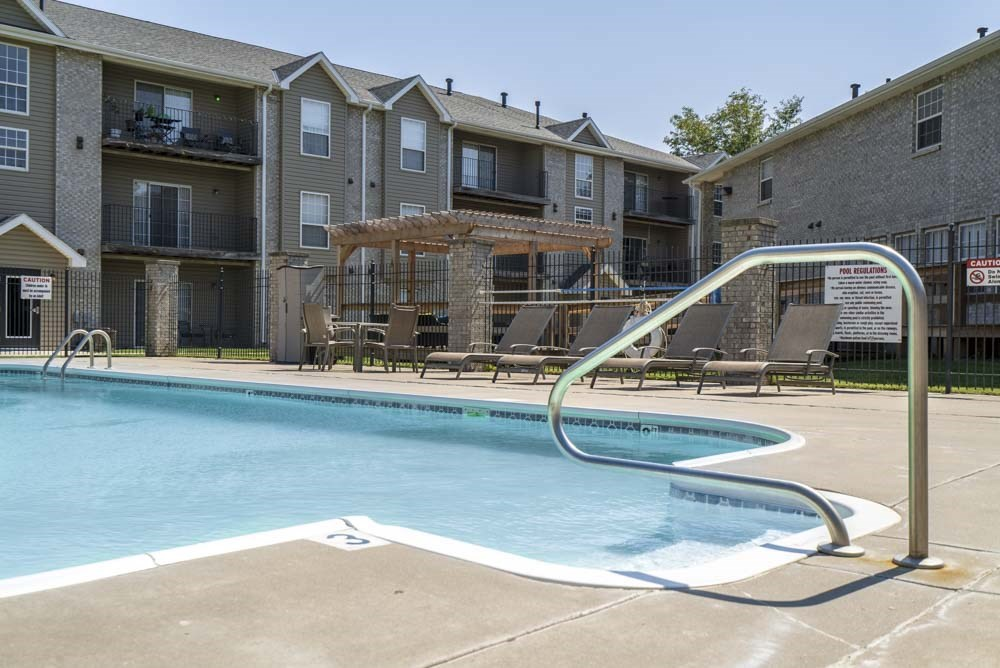 Outdoor pool with view of pergola at Eagle Run Apartments in northwest Omaha 68164