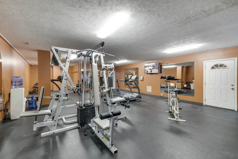 Fitness center with weightlifting machines and cardio equipment at Eagle Run Apartments in northwest Omaha 68164