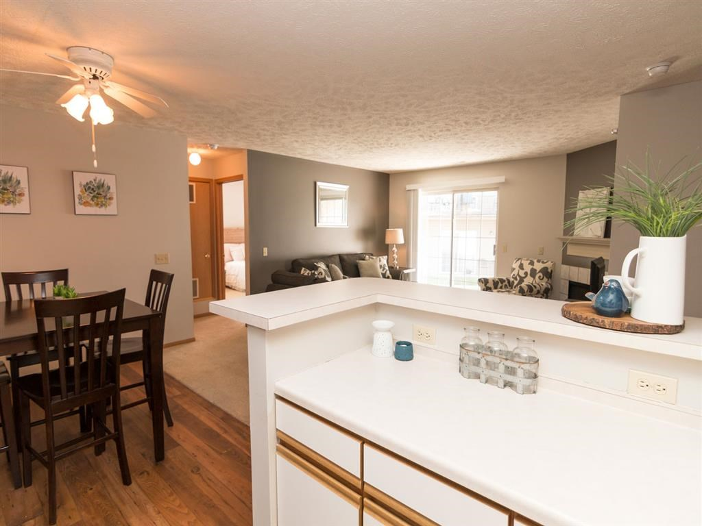 Kitchen view of dining area and living room at Eagle Run Apartments in Omaha, NE
