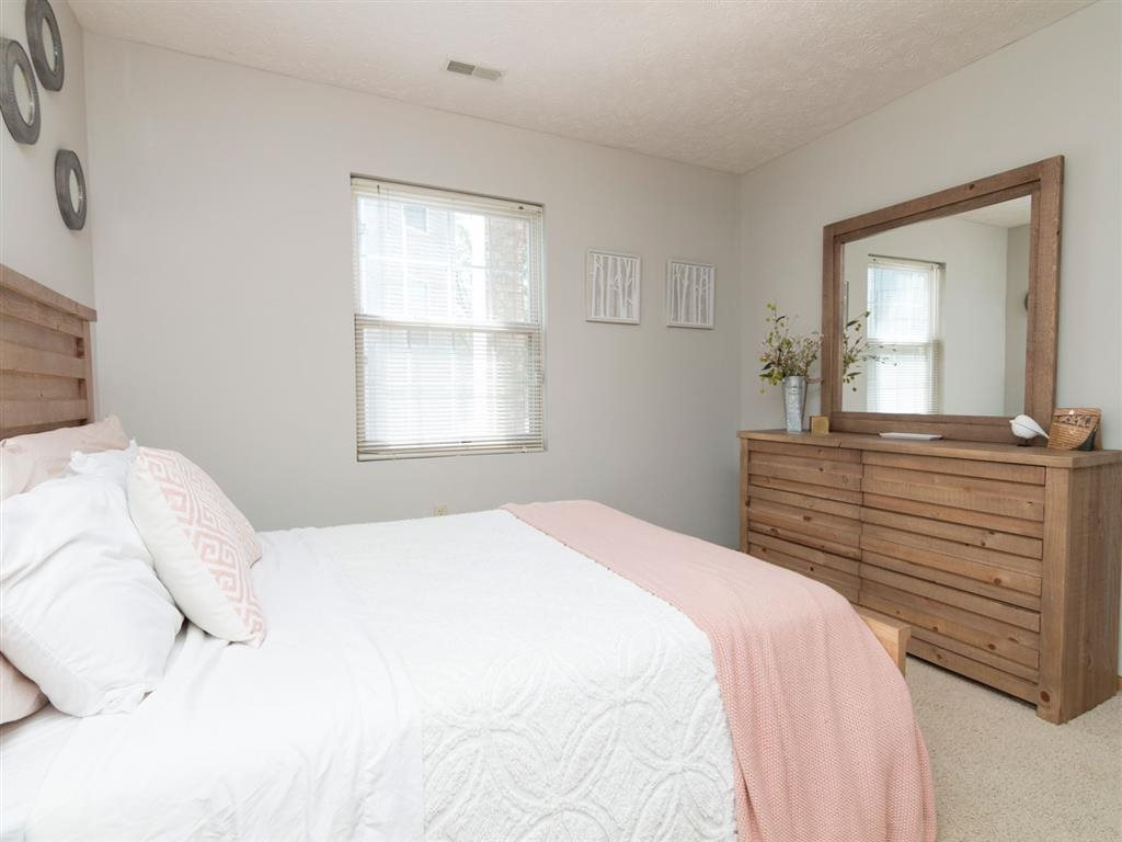 Bedroom with dresser at Eagle Run Apartments in Omaha, NE