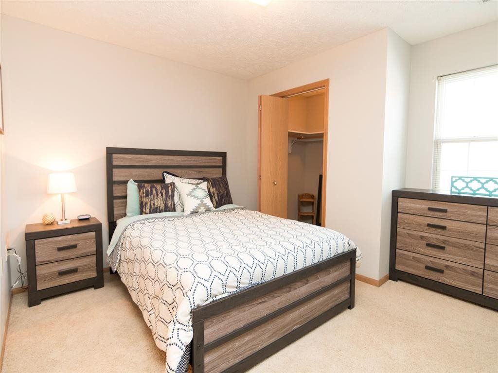 Bedroom with walk-in closet at Eagle Run Apartments in Omaha, NE