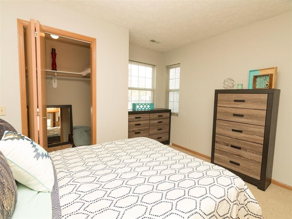 Bedroom with storage space at Eagle Run Apartments in Omaha, NE