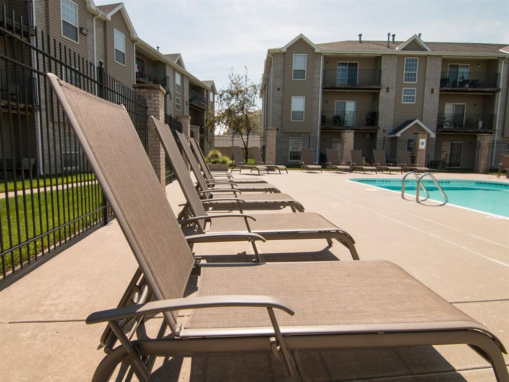 Swimming pool and lounge chairs at Eagle Run Apartments in Omaha NE