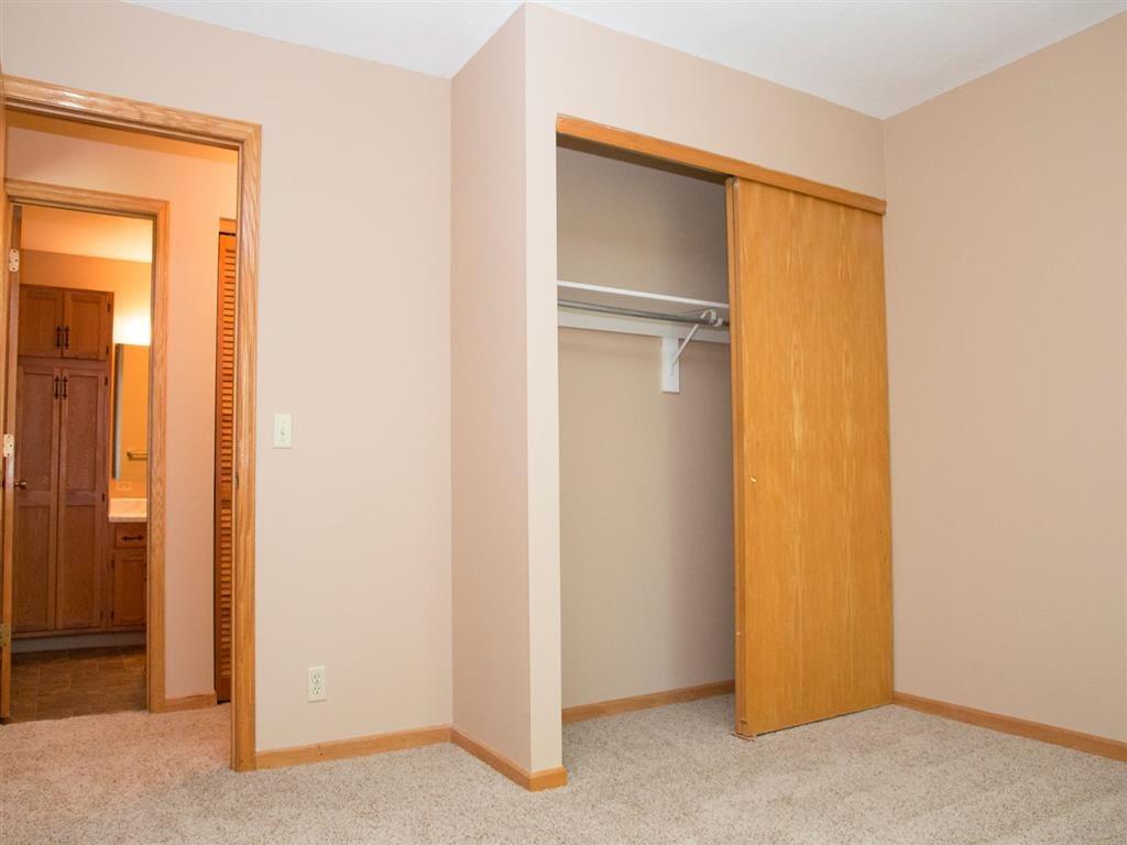 Closet at Oakwood Trail Apartments in Omaha NE