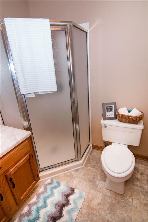 Bathroom with shower at Oakwood Trail Apartments in Omaha NE