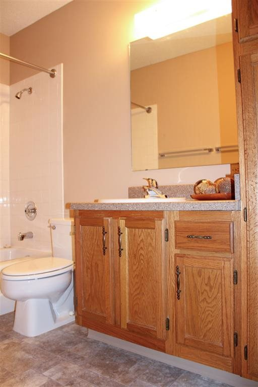 Bathroom at with tub and shower Oakwood Trail Apartments in Omaha NE