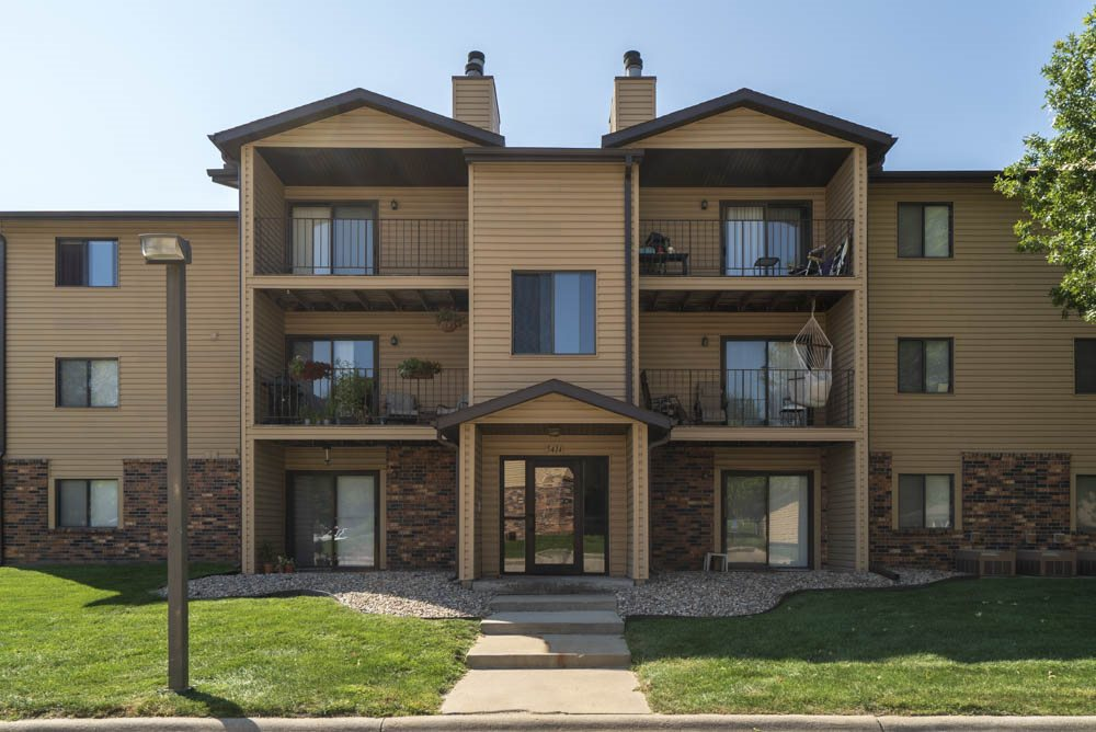 Exterior view of building with balconies and patios at Oakwood Trail Apartments in northwest Omaha, NE, 68164