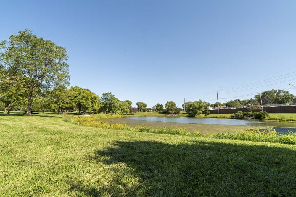 View of Rambleridge Park and pond next to Oakwood Trail Apartments in northwest Omaha, NE, 68164