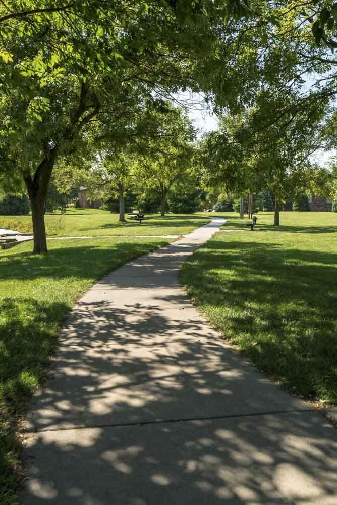 Walking path through Rambleridge Park next to Oakwood Trail Apartments in northwest Omaha, NE, 68164