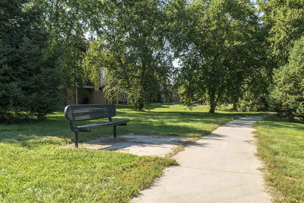 Park bench along Rambleridge Park walking path at Oakwood Trail Apartments in northwest Omaha, NE, 68164