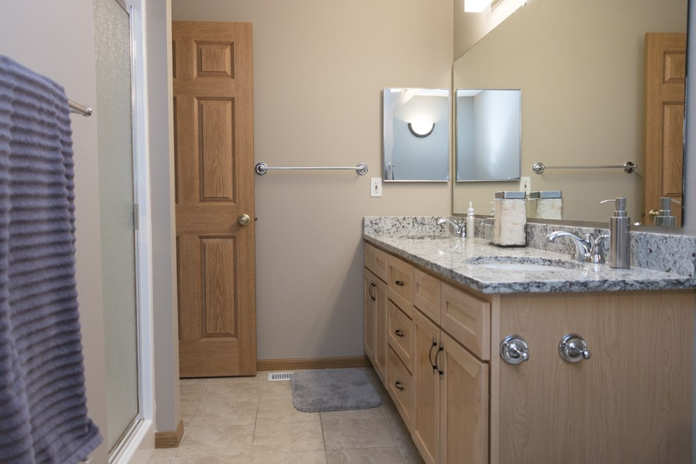 Granite countertops in bathroom with shower in master bath-Southwind Villas