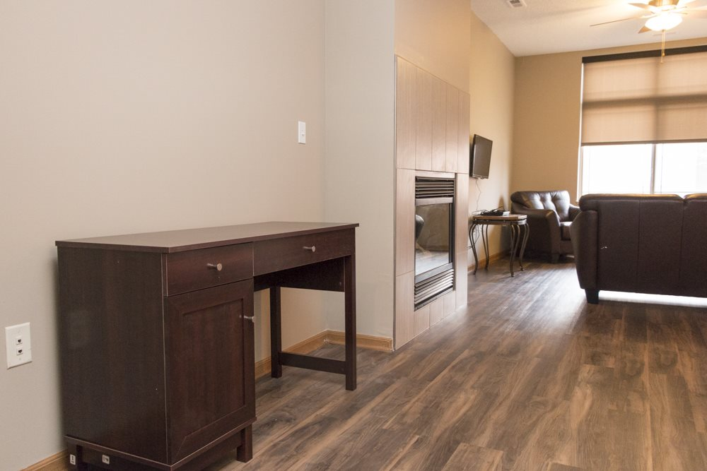 Two bedroom townhome entryway with hardwood-style floors