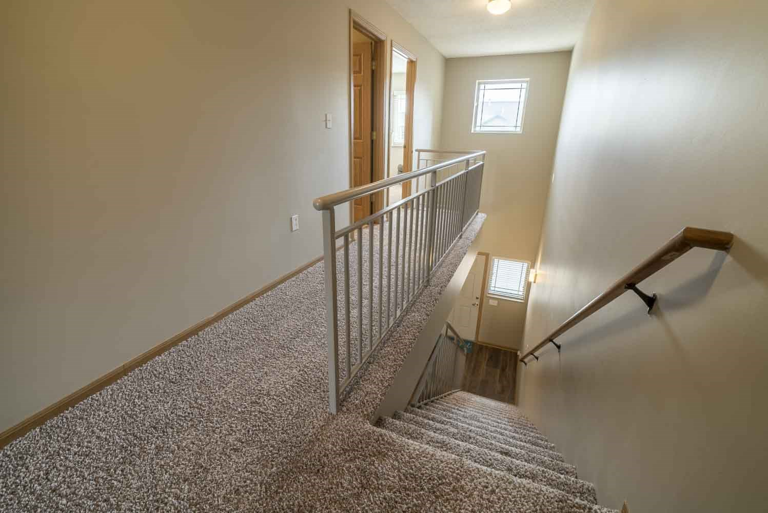Stairwell to upstairs in a two-bedroom townhome at Southwind Villas in southwest Omaha in La Vista, NE, 68128