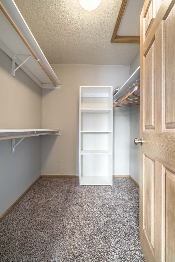 Large walk-in closet with shelving at Southwind Villas in southwest Omaha in La Vista, NE, 68128