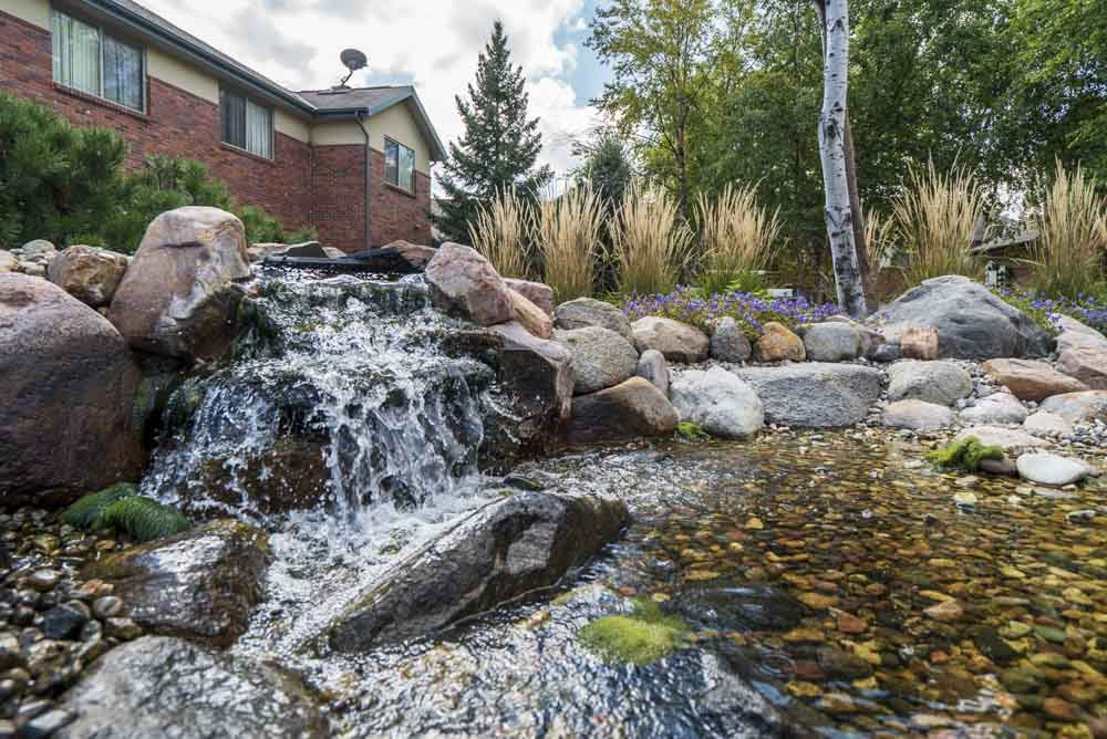 Rock fountain and pond in the courtyard  at Southwind Villas in southwest Omaha in La Vista, NE, 68128