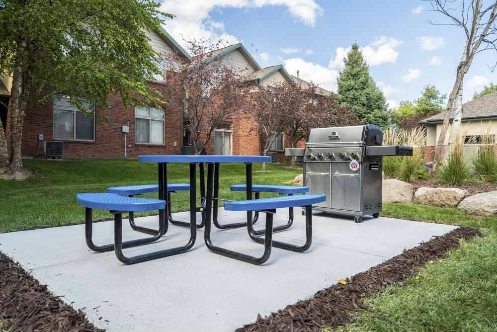 Picnic table with outdoor grill  at Southwind Villas in southwest Omaha in La Vista, NE, 68128