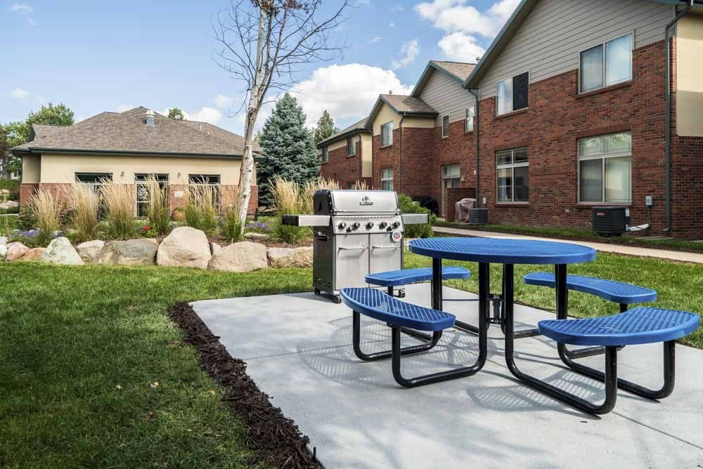 Outdoor grill with picnic table in the courtyard  at Southwind Villas in southwest Omaha in La Vista, NE, 68128