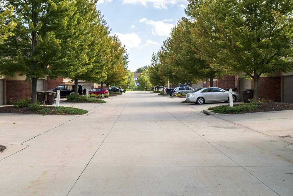 Wide neighborhood streets lined with mature trees  at Southwind Villas in southwest Omaha in La Vista, NE, 68128