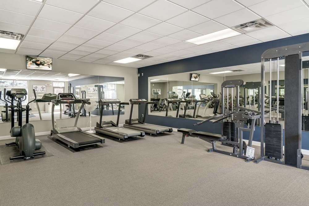 24-hour fitness center with cardio equipment and weightlifting machines at Southwind Villas in southwest Omaha in La Vista, NE, 68128