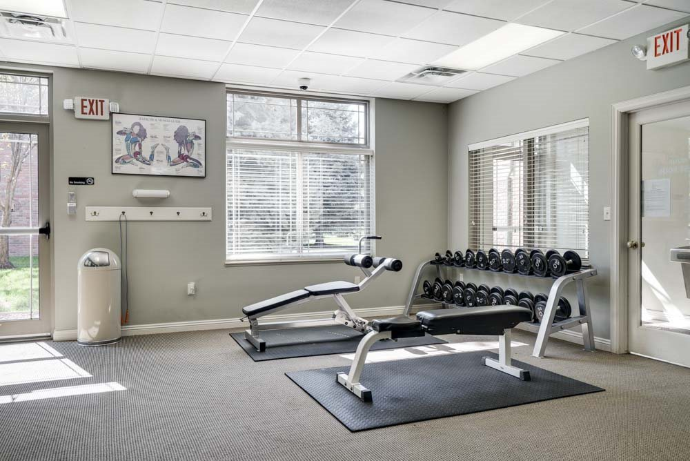 Free weights and strength benches at Southwind Villas in southwest Omaha in La Vista, NE, 68128q