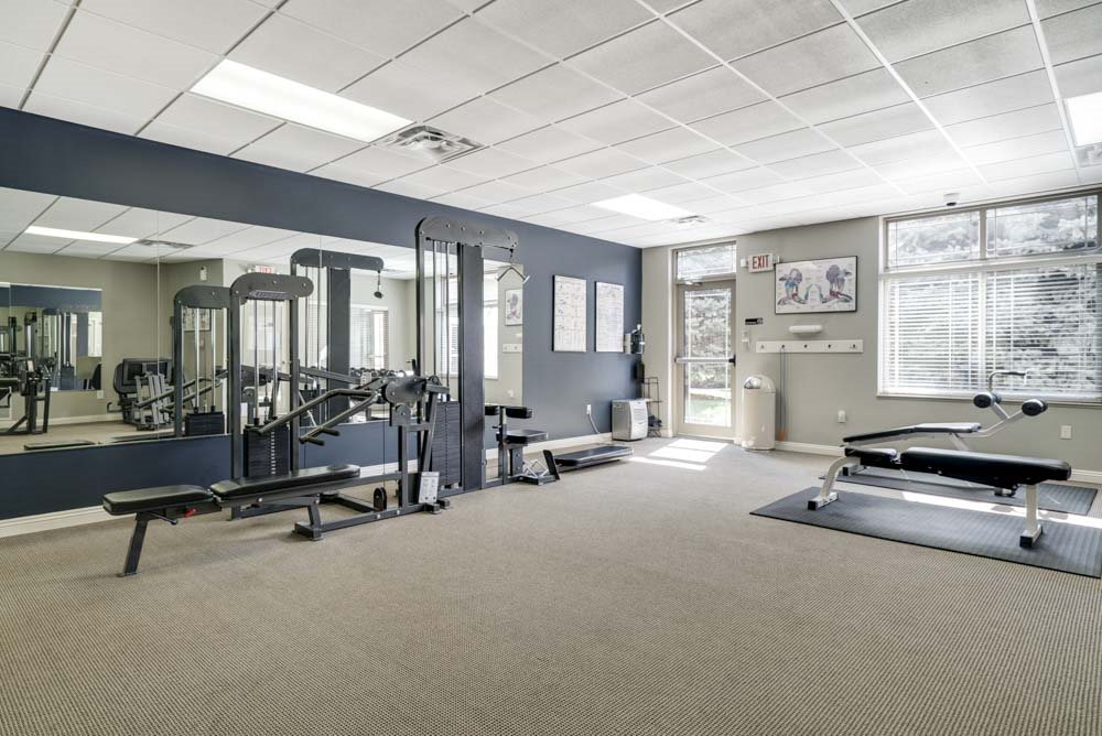 24-hour fitness center with weightlifting machines at Southwind Villas in southwest Omaha in La Vista, NE, 68128