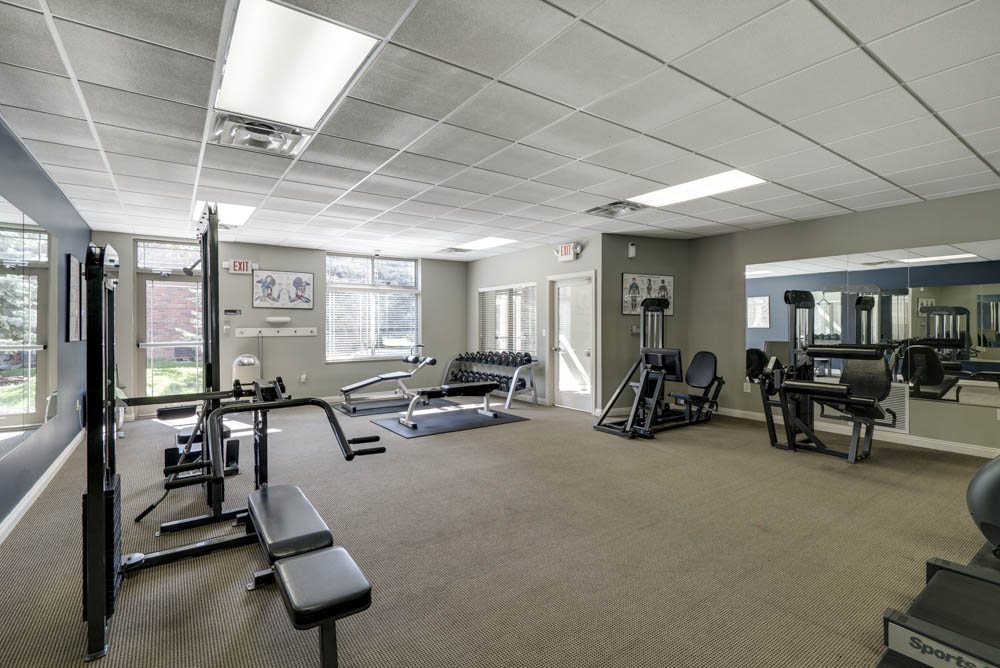 24-hour fitness center with free weights and weightlifting machines at Southwind Villas in southwest Omaha in La Vista, NE, 68128