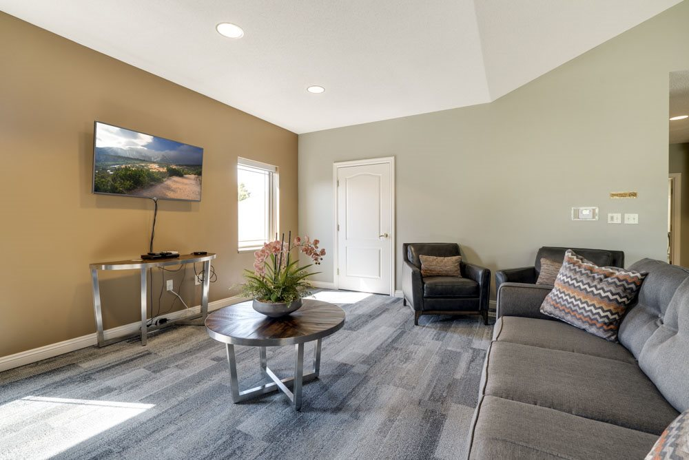 TV lounge with couches at Southwind Villas in southwest Omaha in La Vista, NE, 68128