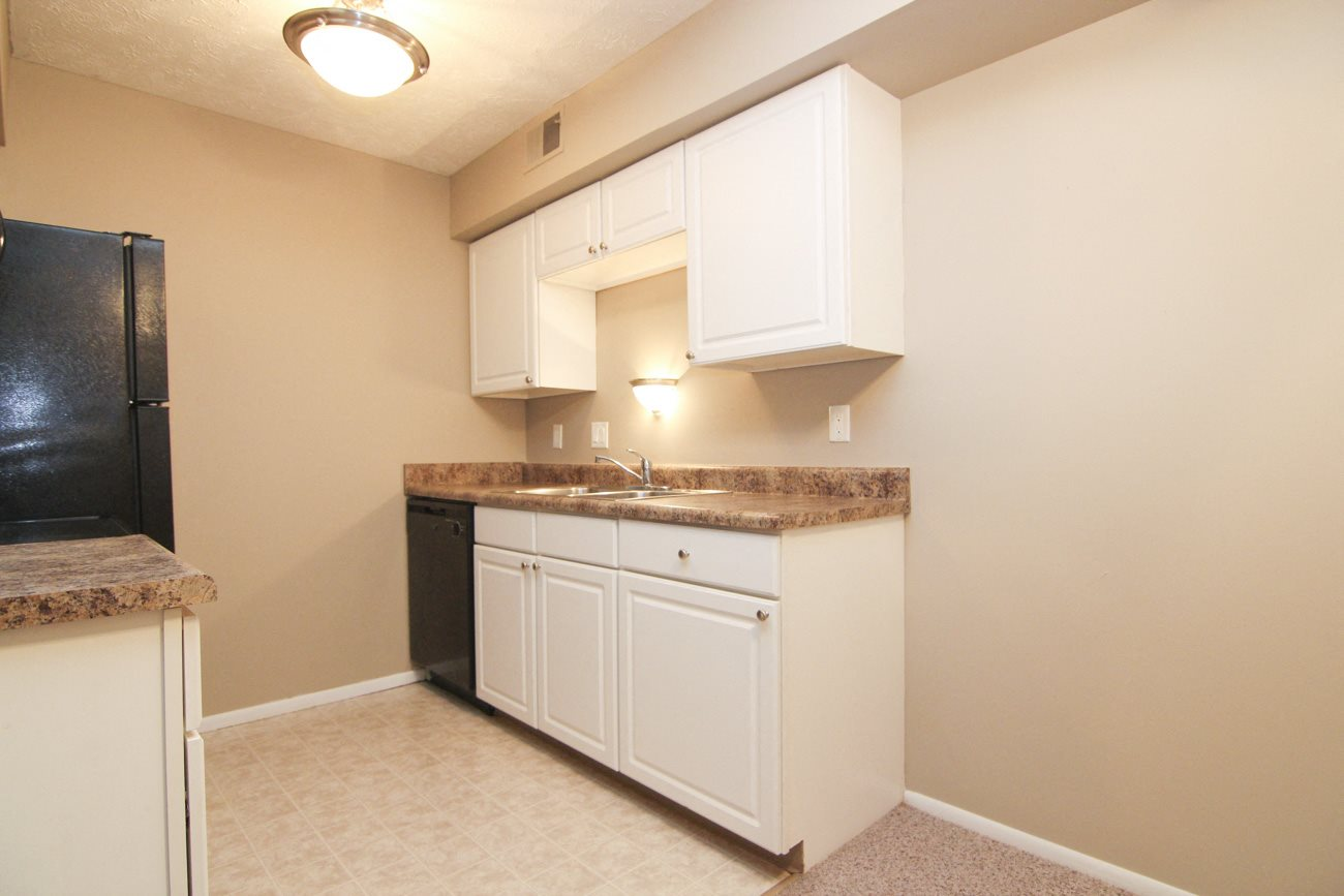Interiors-Place 72 Apartments remodeled kitchen with white cabinets