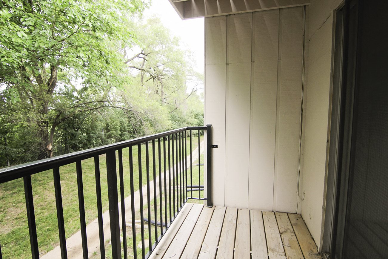 Interiors-Place 72 Apartments balcony viewing wooded area