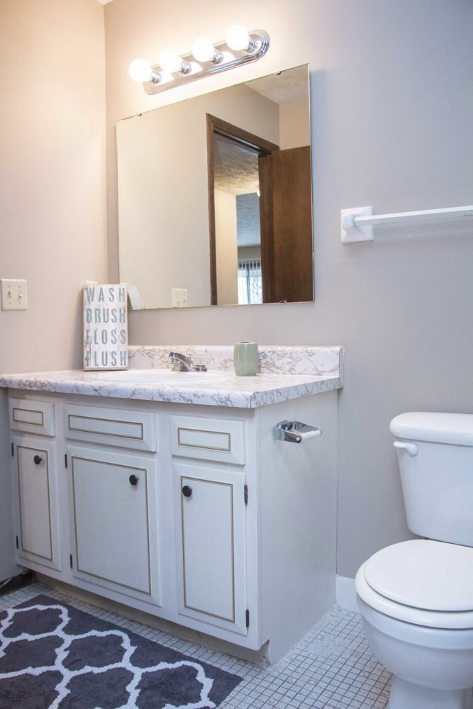 Bathroom with white cabinetry at Place 72 Apartments near Aksarben
