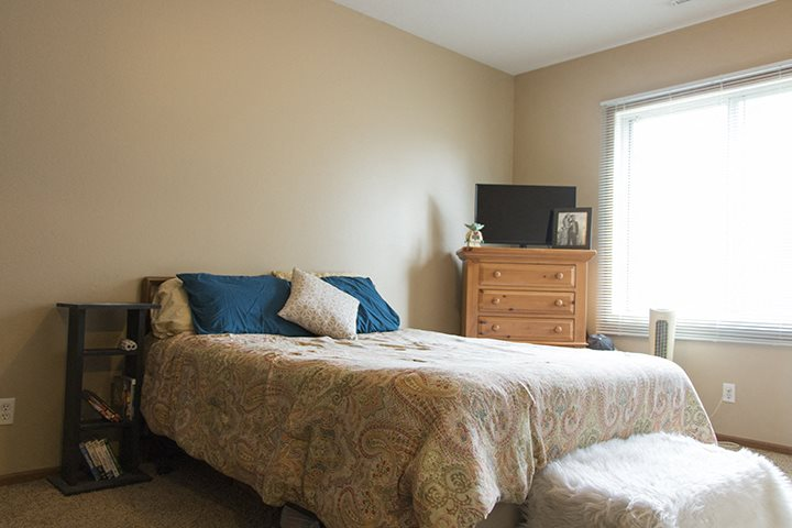 Large furnished bedroom with large windows at Wyndham Heights