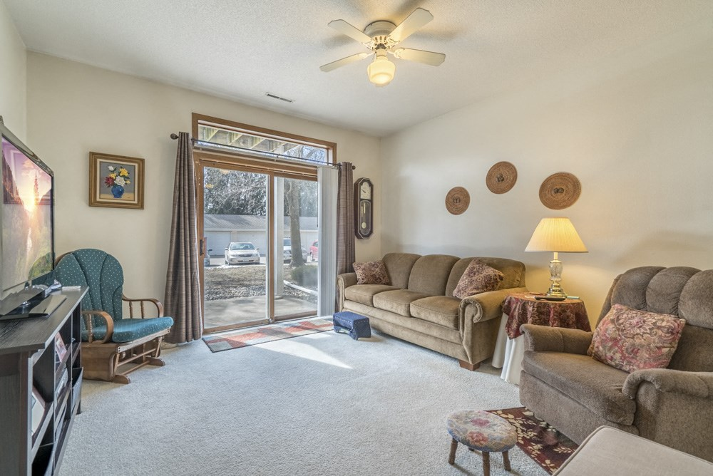 Interiors-Living room with ceiling fan in 2-bedroom apartment
