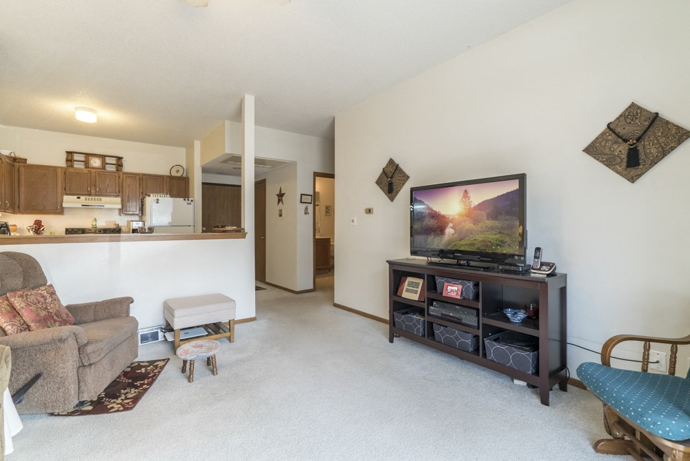 Interiors-Living room with kitchen view in 2 bedroom apartment at Wyndham Heights