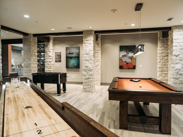 Game Room equipped with Billiards and Shuffle Board at Ridgeline at Rogers Ranch, TX,78257