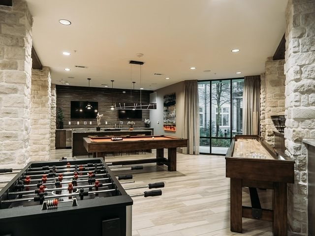 Ridgeline at Rogers Ranch, has Game Room equipped with Billiards and Shuffle Board